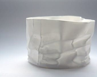 White vase. Crumpled paper looking vessel made out of English fine bone china with a hint of mother of pearl - iridescent
