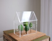Miniature greenhouse style acrylic house with little hand carved trees