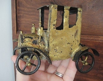 One of a kind vintage fancy metal car made with recycled material. Perfect for home deco and car lover.