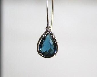 Sterling Silver earrings with Montana blue teardrops.