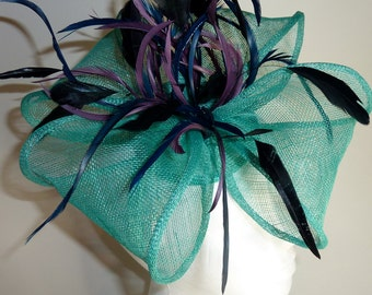 Green flower fascinator with purple and black feathers