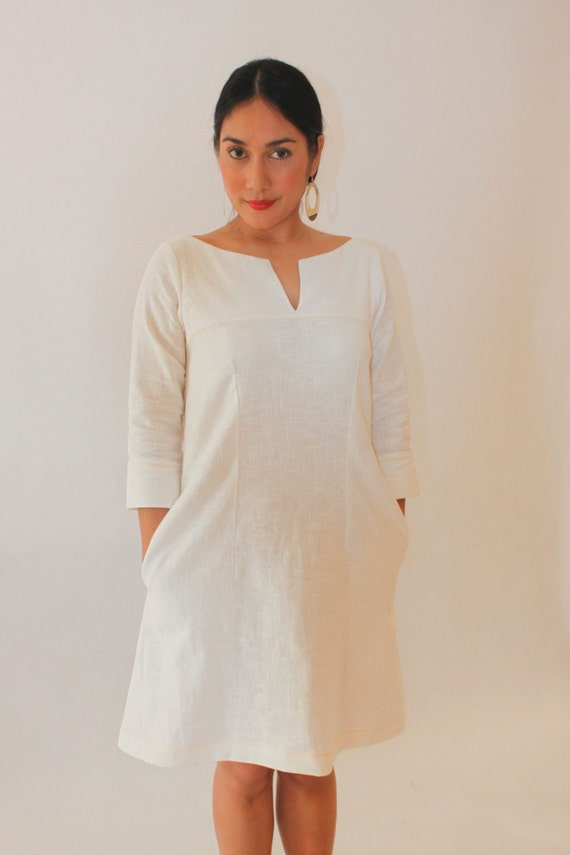 Style 4033 - Shift dress in white linen with three-quarter sleeves.