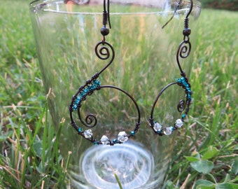 Black wire earrings with teal and clear beads