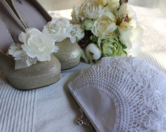 Emma, a Doily Clutch in white, made from a vintage hand crocheted doily.One of a kind