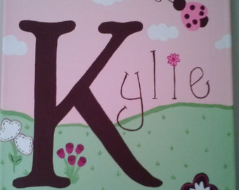 Hand Painted Name Canvas with Ladybug and Flower Theme