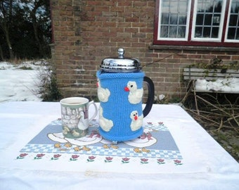 Hand knitted blue cafetiere hug with applique ducklings