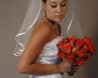 "Wedding veil 22"" past shoulder with folded satin ribbon. Bridal veil with folded satin ribbon."