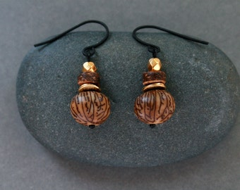 small ethnic earrings with exotic brown seeds and brass - natural tropical jewelry - black ear wires