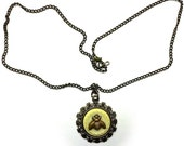 Vintage flower button with brass bee pendant necklace