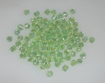 Swarovski Chrysolite  Crystal 4mm Helix Beads, 25 pcs