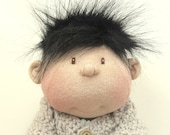 14 inch soft doll carmel color black hair brown eyes