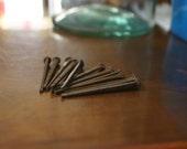 lot of 24 (2 dozen) antique 1930s cut steel square head 6D nails