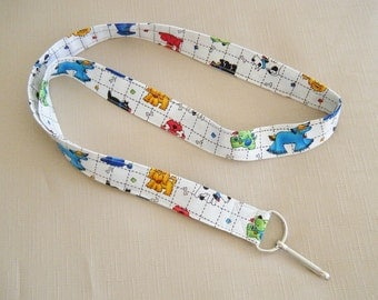 Dogs and cats on white - handmade fabric lanyard