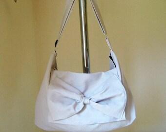 Adjustable strap bow Messenger bag in Natural canvas ecru off white bag color variations avaliable