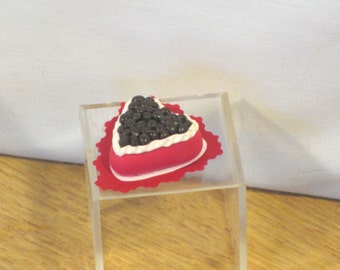 Miniature Valentines day cake topped with chocolate
