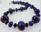 Odyssey - Handmade lampwork sterling silver black onyx and blue agate necklace
