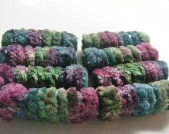 We're totally into swapping scenes and styles.  Anything to maintain our bad-bead status. Fiber Bead set, Artisan jewelry textile dread tube