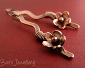 Antiqued copper earrings with a hammered squiggle wire wrapped with a copper flower