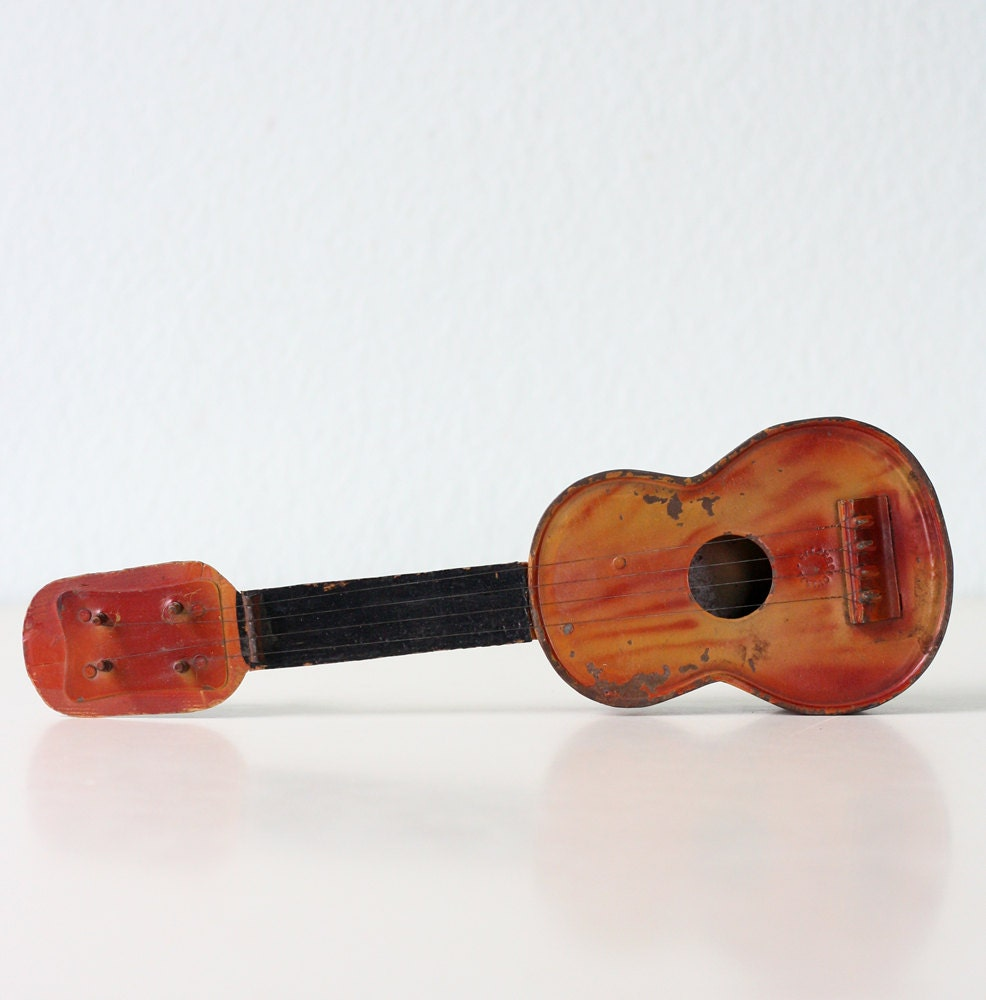 vintage tin toy ukulele czechoslovakia. Black Bedroom Furniture Sets. Home Design Ideas