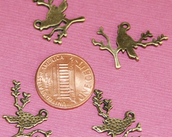 10 pcs of antique brass bird on branch pendant 21x15mm