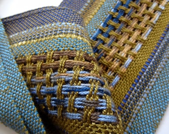 handwoven scarf in autumn olive and blues