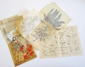 package of embroidery transfers including stitch guide