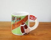 vintage 90s We Are The Vistors Football Sports Fan Hand and Ball Mug