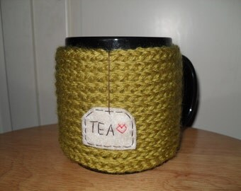 knitted tea mug cozy cup cozy in pea green with hand embroidered hanging tea patch with red heart