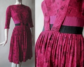 Darling early 1960's party dress, rose print soft jersey knit in fuschia, wine, and black, with double grosgrain sash, small / medium