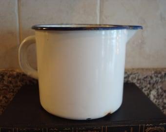 Vintage white enamelware pitcher with cobalt blue trim