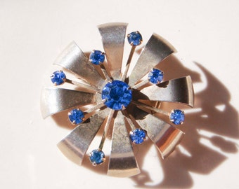Vintage Silver Burst Brooch with Blue Sapphire Stones