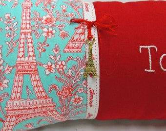 "Toujours pillow- hand-embroidered on red cotton with Eiffel Tower print, ""Amour"" twill tape, brass charm"