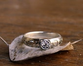Sterling Silver Ring with white Zirconia Gemstone decorated with 14kt golden snakes
