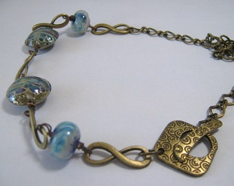 Handmade Lampwork Glass and Brass Necklace - Blue Infinity (N-188)