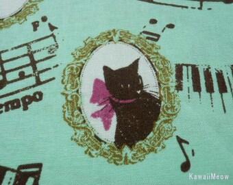 "SCRAP / KOKKA Cats Piano Music on Emerald Green - 108cm/42.5""W x 45cm/17.7""L (ko130419)"
