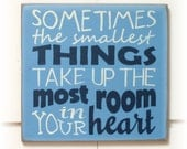 Sometimes the smallest thing take up the most room in your heart typography wood sign