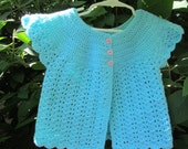 Swing sweater for baby in turquoise with pink buttons