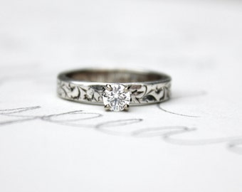 custom ethical diamond engagement ring . recycled fine silver band . 10k white gold prong setting . made to order in your size