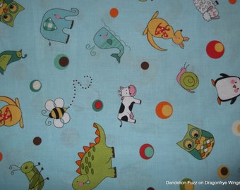 One Yard of Tossed Alphabet Animals on Blue Fabric