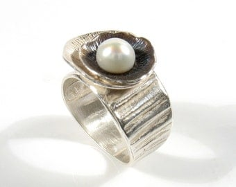 Silver shell and pearl ring,partly oxidized. What is inside the shell,ring.