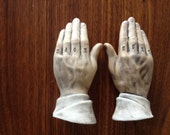 Knuckle tattoo prayer hands