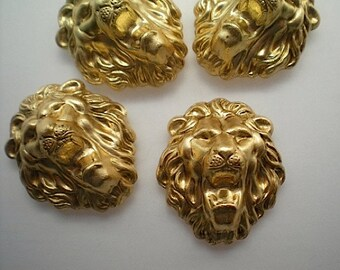 4 lion head charms