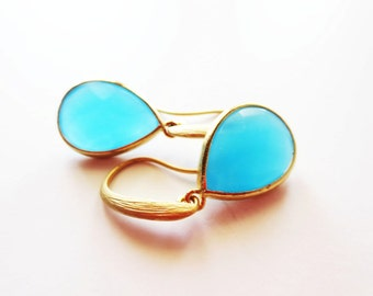 Aqua earrings.  Blue earrings.  Framed glass earrings.  Dangle earrings.  Gold earrings.