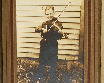 Humble beginings of a great performer...  portfolio portrait of a boy playing violin... May 10