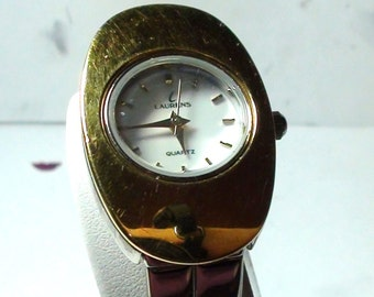 1990s  Lauren Wrist Watch,Modernist. Face, and 18k gold Plate  and Silver tone Bracelet Working