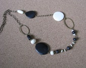 Vintage asymmetrical metal bead necklace with black white cream beads