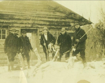Fox Hunting Men Standing With Long Guns Winter Snow Log Cabin 1920s  Antique Picture Vintage Photo Snapshot Black White Photograph