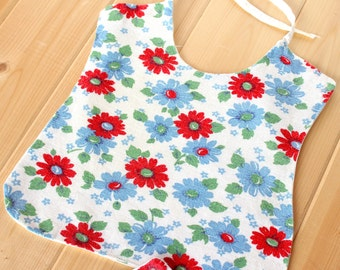 Two vintage baby bibs made from feedsack cotton