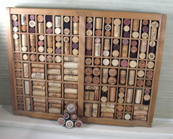 wine cork bulletin board made from vintage printer by