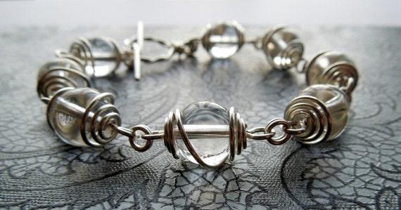 Divination - sterling silver wrapped rock crystal bead bracelet